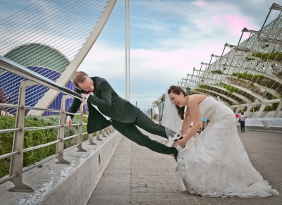 The bride tries to get rid of the groom