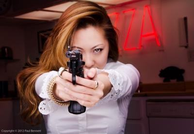 Gun in hand portraiture