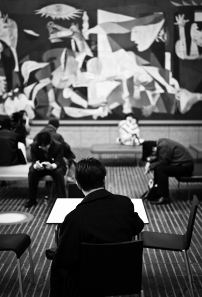 Salarymen relaxing against a Guernica backdrop