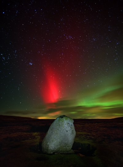 Northern lights over ancient stone
