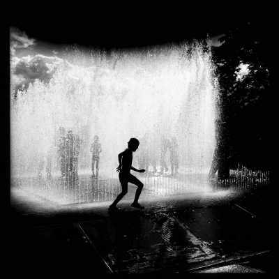 Boy around a fountain