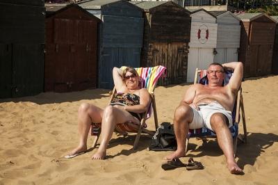 Sunbathing at Broadstairs seaside, UK 2014