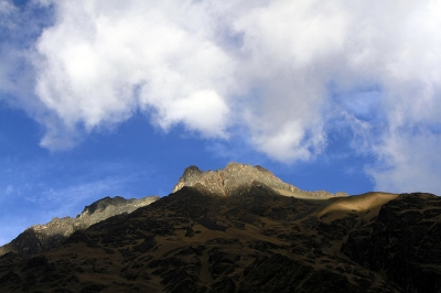 Cloud covered mountain peak near Salcantay glacier in Andes montain range of Peru.