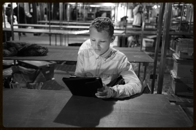 Boy on his Tablet. Greenwich.