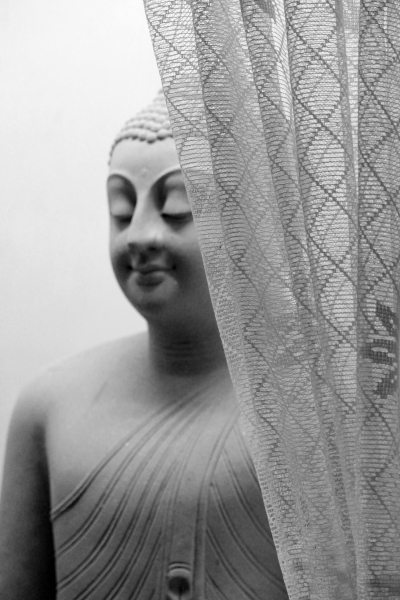 The Buddha Behind a Curtain