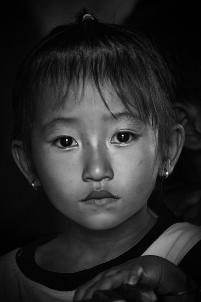 the melancholic and mysterious view of an unknown Viatnamese girl